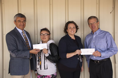 Robert E. Castillo at check presentation at Future Foundations Family Center