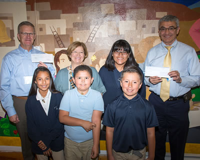 Robert E. Castillo with students from St. Joseph Mission School in San Fidel, N.M.